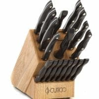 "Cutco Homemakers Knife Set CUTCO Model 1818 Homemaker Set + 8 with #1725 full size chef knife...............18 High Carbon Stainless knives & forks with Classic Dark Brown (often called ""Black"") handles in factory-sealed plastic bags............#1748 Honey Finish Oak knife block, #82 Sharpener, and 10"" x 13"" Poly Prep cutting board also included."