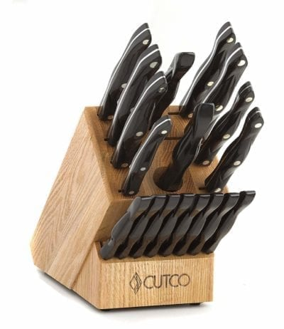 """Cutco Homemakers Knife Set CUTCO Model 1818 Homemaker Set + 8 with #1725 full size chef knife...............18 High Carbon Stainless knives & forks with Classic Dark Brown (often called """"Black"""") handles in factory-sealed plastic bags............#1748 Honey Finish Oak knife block, #82 Sharpener, and 10"""" x 13"""" Poly Prep cutting board also included."""